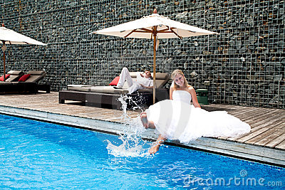 Happy newly wedding couple near pool