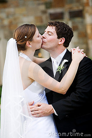 Happy newlywed couple kissing