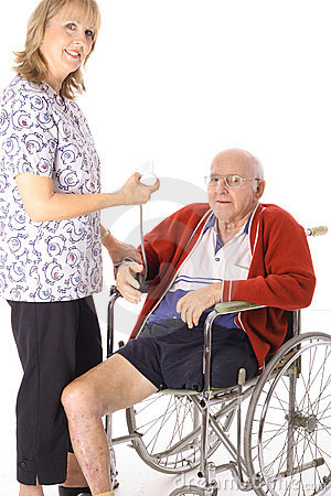 Happy nurse checking elderly patient