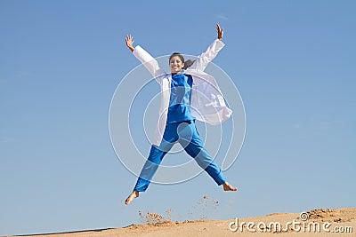 Happy nurse jumping