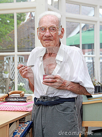 Happy nursing home resident eating Editorial Stock Photo