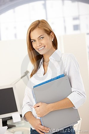 Happy office girl with folders