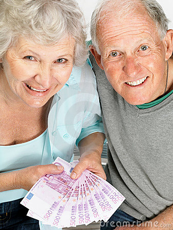 Happy old couple holding money - Top view