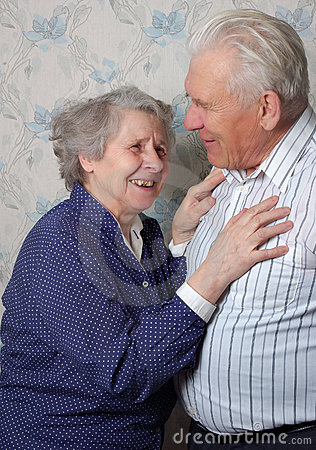 Happy old couple laugh