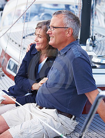 Happy old couple sitting on Yacht