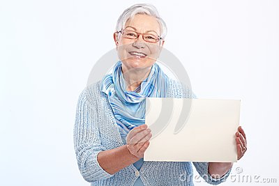 Happy old lady with blank sheet