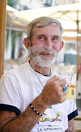 Free Happy Old Man Drinking Beer Royalty Free Stock Photo - 109766635