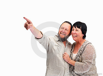 Happy older man pointing upwards to his wife