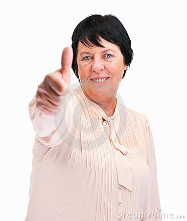 A happy older woman showing thumbs up sign