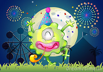 A happy one-eyed monster at the carnival with a firework display
