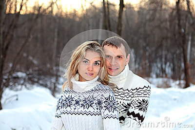 Happy pair in winter forest