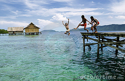 Happy Papua Kids Jumping to sea Editorial Photography