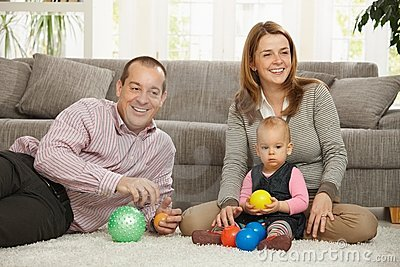 Happy parents with baby girl