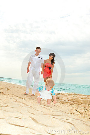 Happy Parents Look At Son Royalty Free Stock Photos - Image: 13815058