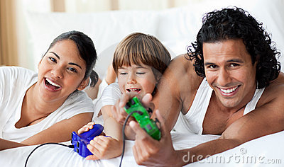 Happy parents and son playing video games
