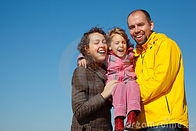 Happy parents together with daughter on hands