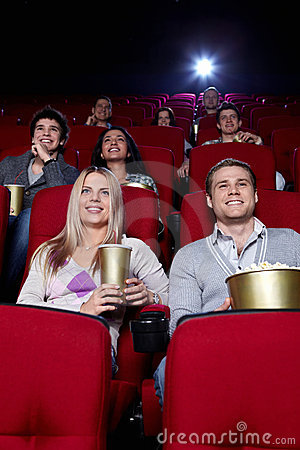 Happy people in the cinema