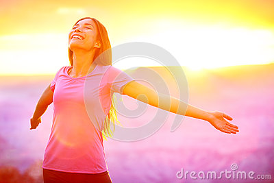Happy people - free woman enjoying nature sunset