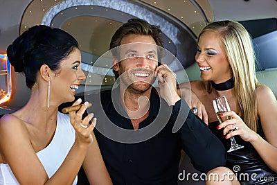 Happy people having fun in luxury car
