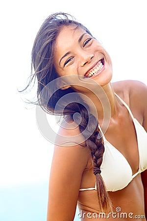 Happy people - joyful smiling woman in bikini