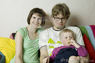 Happy perfect young family with dad, mom and son