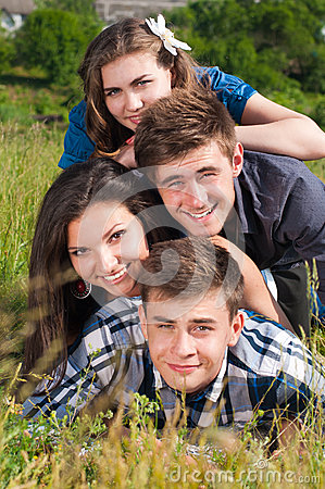 Happy pile: group of Young people & green field