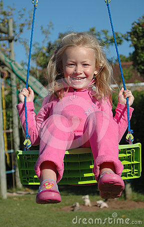 Happy child on swing