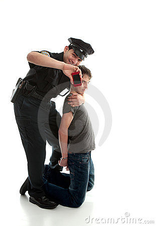 Happy policeman with apprehended teen boy