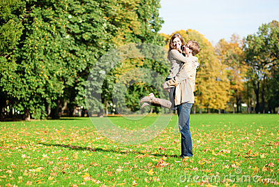 Happy positive couple in park