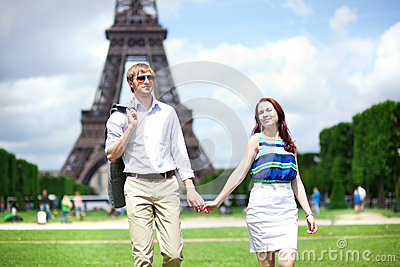 Happy positive couple walking