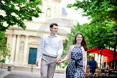 Happy positive couple walking near Sorbonne