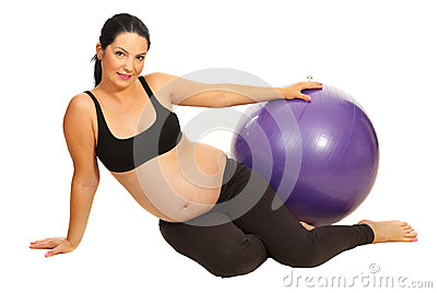 Happy pregnant with pilates ball