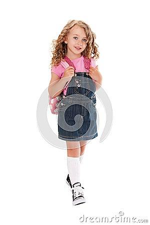 Happy preschooler walking to school