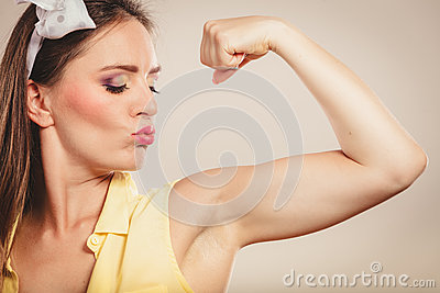 Young girls showing muscles topic