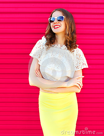 Free Happy Pretty Smiling Woman In Sunglasses And Skirt Over Colorful Pink Royalty Free Stock Photo - 73627545