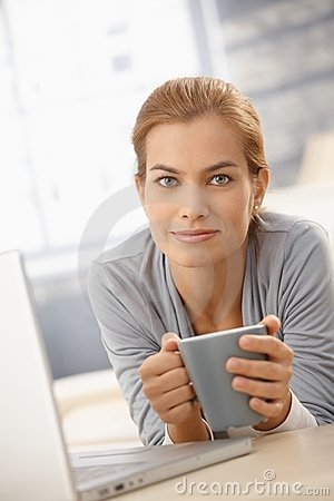 Happy pretty woman with coffee mug