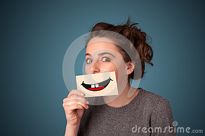 Happy pretty woman holding card with funny smiley Stock Photo