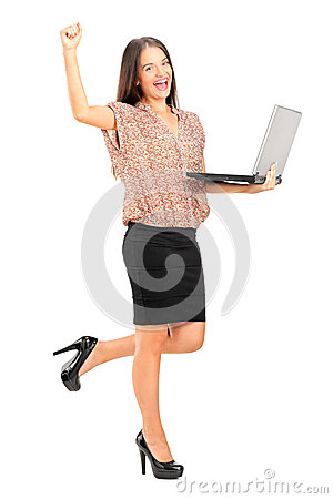 Happy professional woman holding a laptop