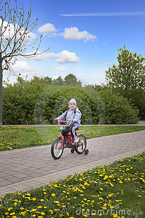 Happy pround girl riding bicycle
