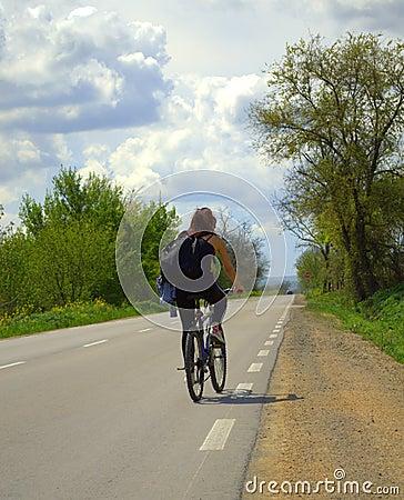 Spring road biker woman Stock Photo