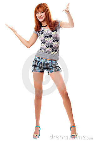 Happy red-haired girl in a t-shirt and shorts