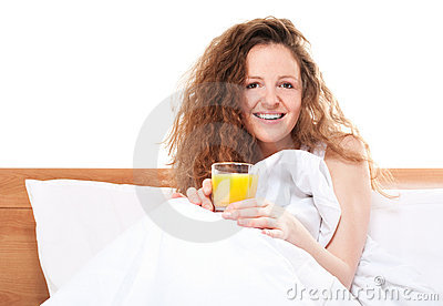 Happy redhead woman in bed