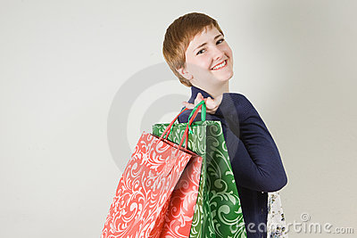 Happy redhead woman with shopping bags