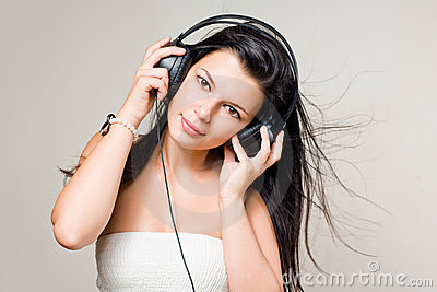 Happy relaxed brunette listening to music.