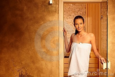 Happy relaxed woman at sauna