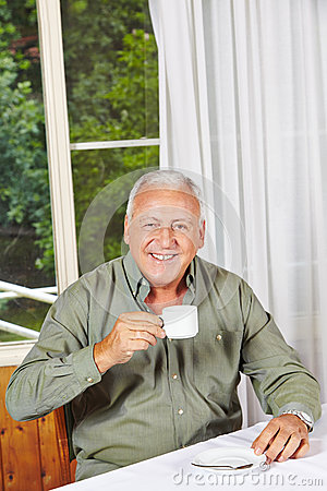 Happy retired man drinking coffee