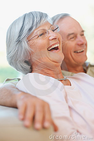 Happy retired old couple laughing out loud