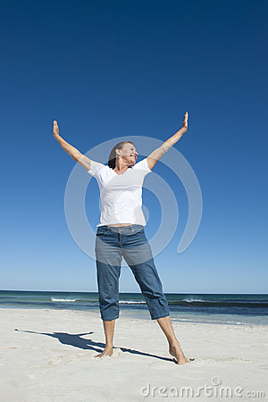 Happy retired woman at beach