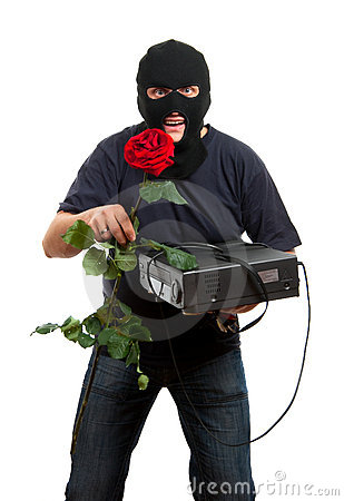 Happy robber come to his girlfriend with a gift