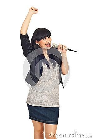 Happy rock girl sing in microphone